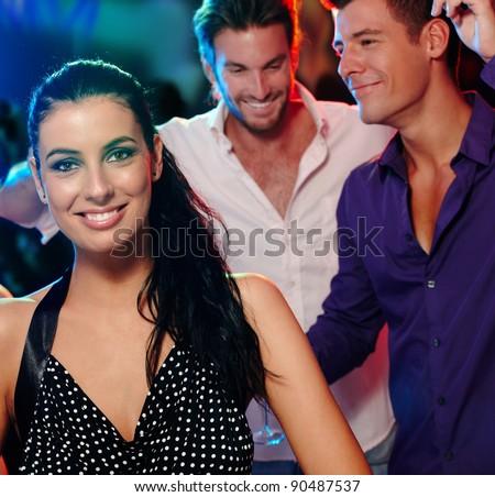 Beautiful young woman and friends having fun in nightclub.? - stock photo