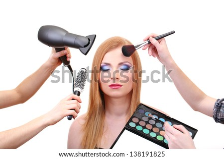 Beautiful young woman and hands with eyes shadows, brush and hairdryer, isolated on white