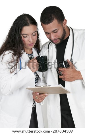 Beautiful young woman and man doctors in a lab coats holding a patient record - stock photo