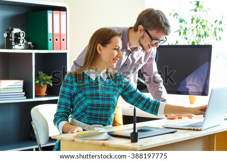 Beautiful young woman and man working from home - modern business concept