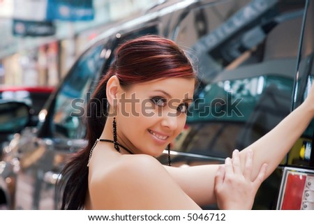 Beautiful young woman and the car. - stock photo