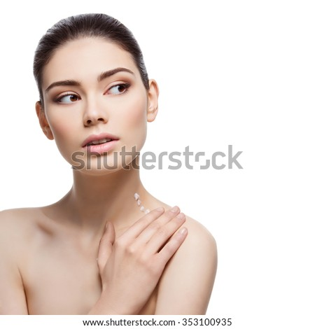 Beautiful young woman applying moisturizing cream to neck and shoulder. Isolated over white background. Copy space. Square composition. - stock photo