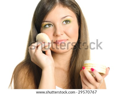 beautiful young woman applying powder with a sponge - stock photo