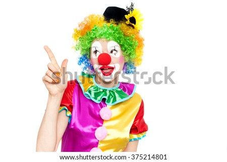 Beautiful young woman as clown - colorful portrait