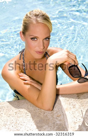 Beautiful young woman at a pool