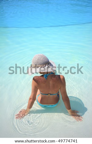 Beautiful young woman at a pool in Greece - stock photo