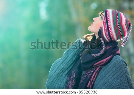 Beautiful young woman at the autumn park. - stock photo