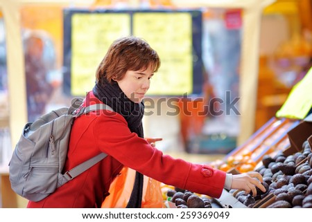 Beautiful young woman at the farmer market  - stock photo