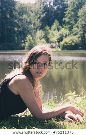 beautiful young woman at the lake in the summer