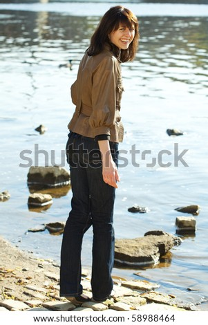 beautiful young woman at the river - stock photo