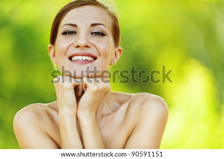 beautiful young woman bare shoulders summer park smiling
