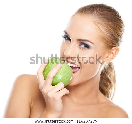 Beautiful  young woman bites a green apple on white - stock photo
