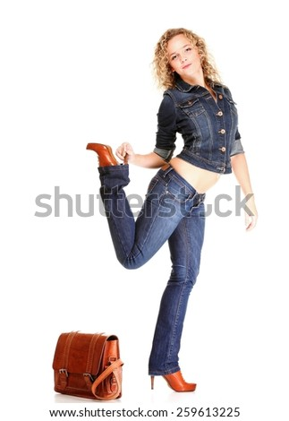 Beautiful young woman blonde 20s standing full body in jeans shoulder bag isolated on white background Caucasian girl - stock photo