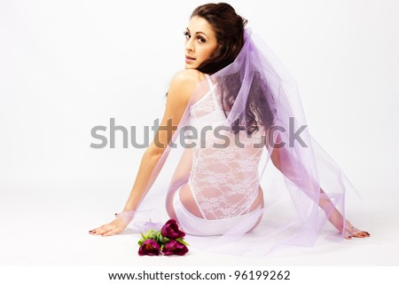 Beautiful young woman bride  with bouquet of tulips - stock photo