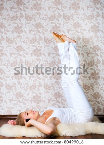 beautiful young woman calling by phone on the floor of the house