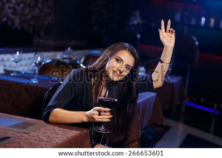Beautiful young woman calling the waitress or waiter for the ordinance. - stock photo