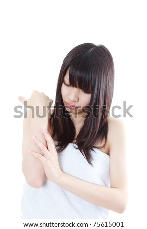 beautiful young woman caring for her arm isolated on white background