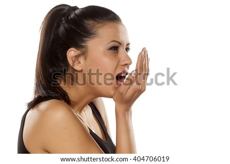 beautiful young woman checking her mouth odor - stock photo