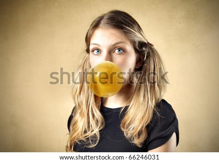 Beautiful young woman chewing a chewinggum - stock photo