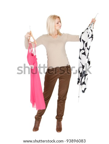 Beautiful young woman choosing dress to wear. Isolated on white - stock photo