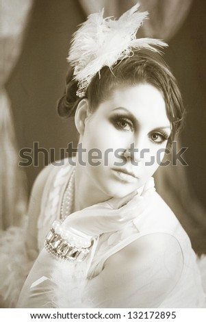 Beautiful young woman close up portrait in retro flapper style headband Vogue style vintage - stock photo