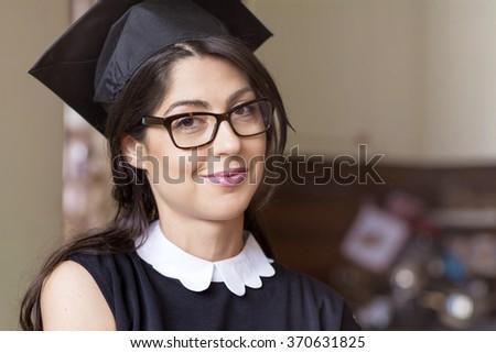 beautiful young woman college graduation - stock photo