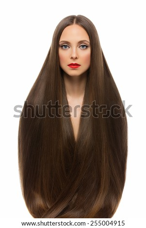 Beautiful young woman covered with her long dark brown hair - stock photo