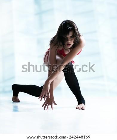 Beautiful young woman dancing - stock photo