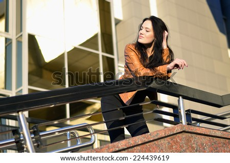 Beautiful young woman daydreaming - stock photo