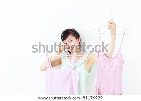 Beautiful young woman deciding what to wear