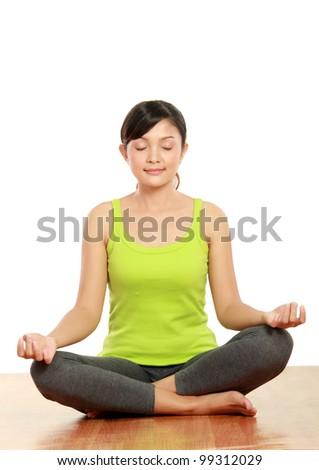 Beautiful young woman doing exercise. Yoga - stock photo