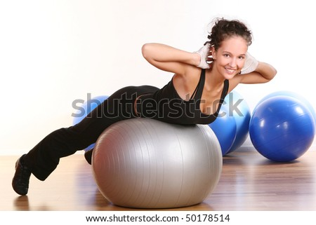beautiful young woman doing fitness exercises - stock photo
