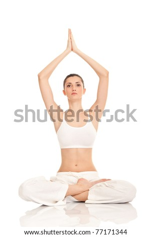 beautiful young woman doing yoga exercise, isolated on background