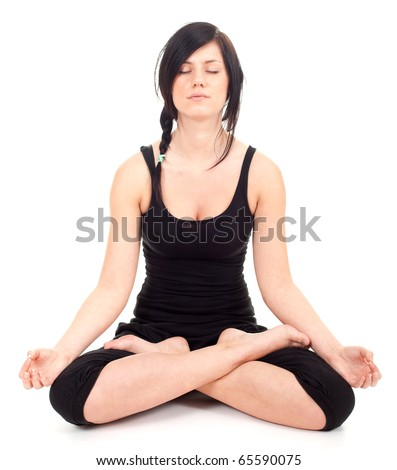 Beautiful young woman doing yoga exercise, meditation in lotus pose - stock photo