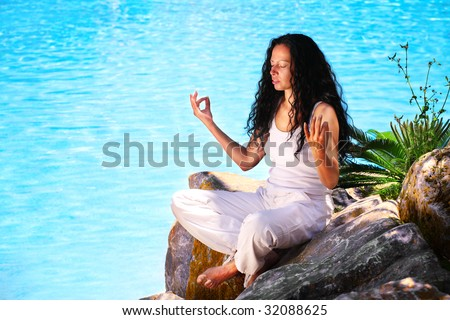 beautiful young woman doing yoga exercise outdoors - stock photo