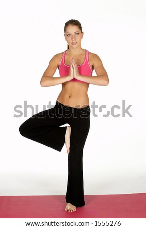 Beautiful Young Woman Doing Yoga Pose - stock photo