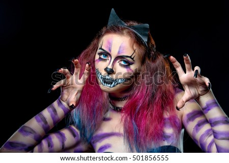 Beautiful young woman dressed as a cat. Make up cat. Halloween