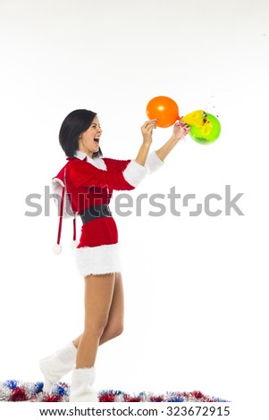 Beautiful young woman dressed as Santa Claus on a white background, emotional, cheerful. He is smiling and jumping sports. Good positive mood, Christmas and New Year.  balloon