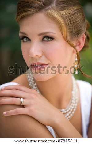 Beautiful young woman dressed elegantly outdoors - stock photo