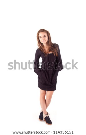 Beautiful young woman dressed for winter - stock photo