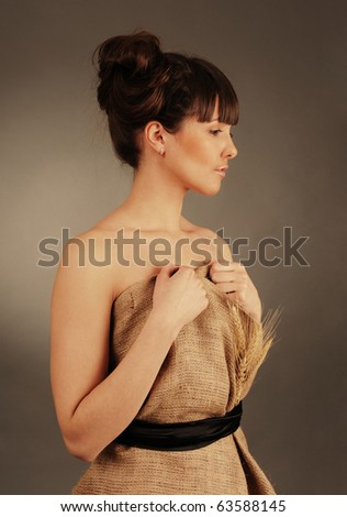 Beautiful young woman dressed in clothes made of natural fabric. - stock photo