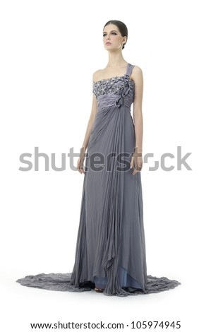 Beautiful young woman dressed in evening gown isolated over white background - stock photo