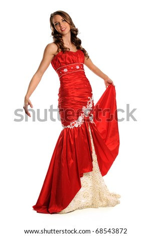 Beautiful young woman dressed in red bridal gown isolated over white background