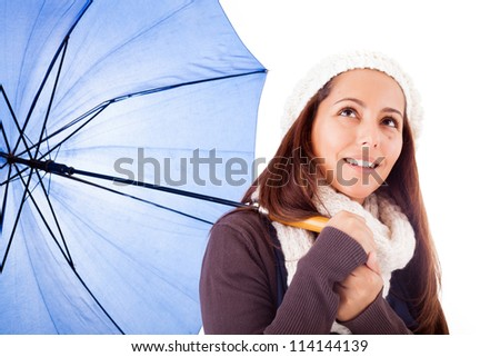 Beautiful young woman dressed with winter clothes looking up, isolated on white