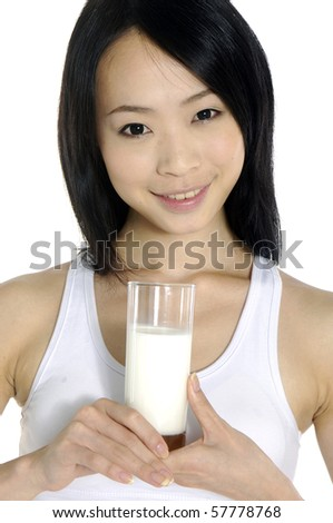 Beautiful young woman drinking a glass of milk on white. - stock photo