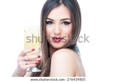 Beautiful young woman drinking lemonade, isolated on white - stock photo