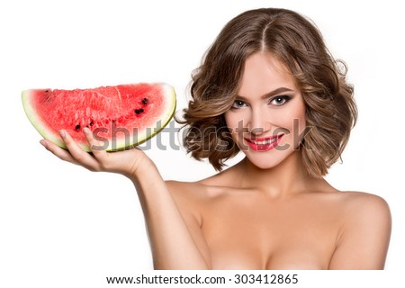 Beautiful young woman eat juicy watermelon  - stock photo