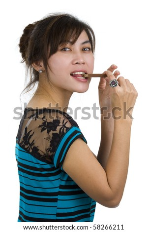 beautiful young woman eating chocolate, isolated on white background - stock photo