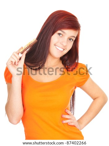 beautiful young woman eating granola bar, white background - stock photo