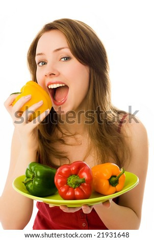 beautiful young woman eating peppers isolated against white background